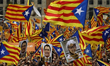 """Pro independence supporters wave """"estelada"""" or pro independence flags during a protest in Barcelona in November. (AP Photo/Manu Fernandez)"""