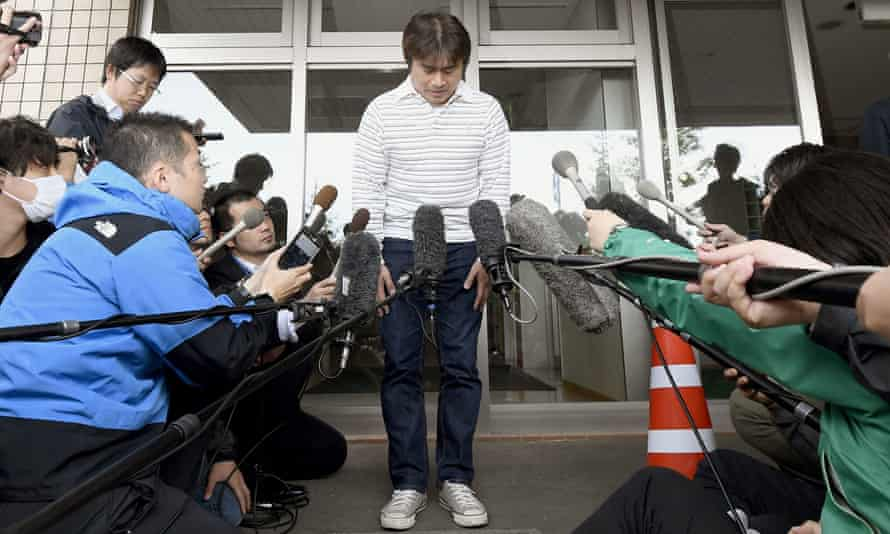 Takayuki Tanooka bows in front of the media