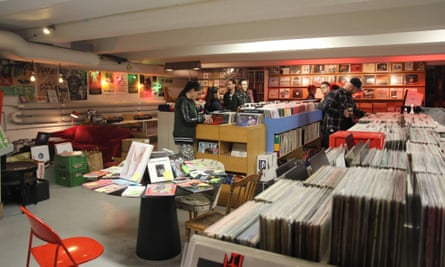 Customers browse through stacks of vinyl at Snickars Records, Stockholm, Sweden