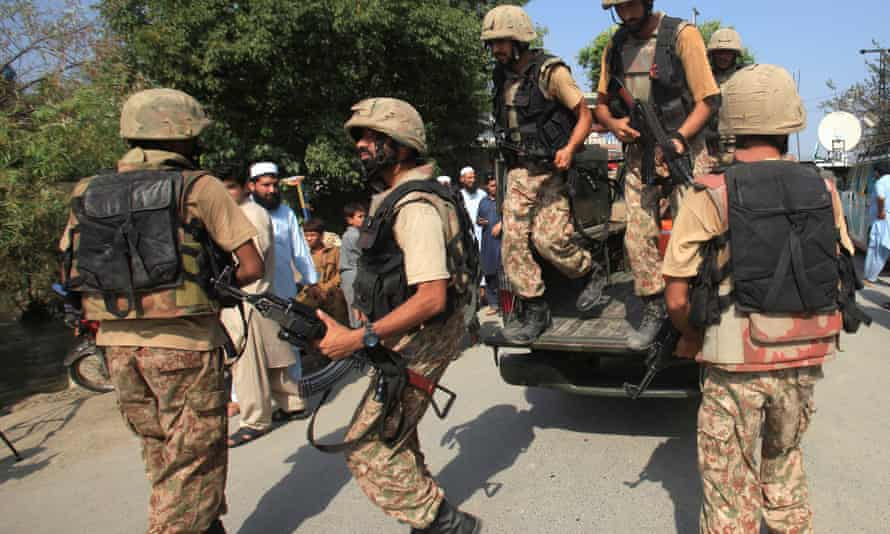 Soldiers arrive at a street after suicide bombers attacked a Christian neighbourhood in Pakistan