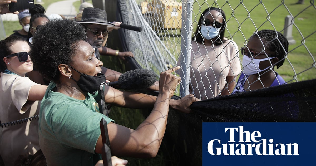 Tulsa race massacre: 19 bodies reinterred as protesters demand criminal investigation