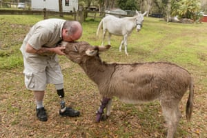 Ronnie with Luigi, a mini donkey for whom he made a prosthetic leg, Webster, FL, 2015'These photos show us that the Peaceable Kingdom — the state of harmony among all creatures — dwells within us, and that the face of bliss belongs to us all'