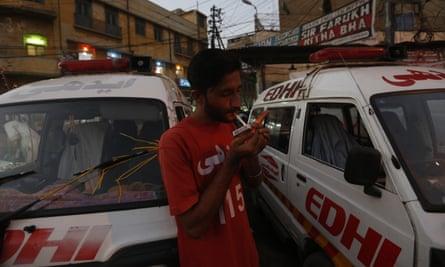 Safdar lights a cigarette during a moment of downtime