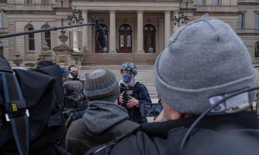 A member of the Boogaloo Bois, an anti-government group, speaks to the press in front the Capitol building in Lansing, Michigan, on Sunday.