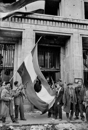 Young rebels later cut out the Communist Rakosi coat of arms from the Hungarian flag