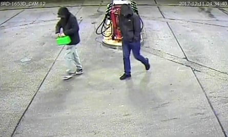 At CCTV still issued by Greater Manchester police shows David Worrall and Zak Bolland buying petrol.