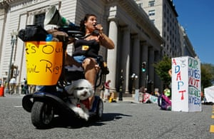 Roxan Perez and her service dog Max join a 2010 protest in Washington, DC