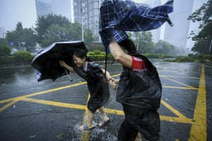 People fight against the wind in Shenzhen, China