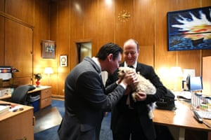 Jared Polis, right, and first gentleman Marlon Reis talk in the govenor's suite with their dog Gia.