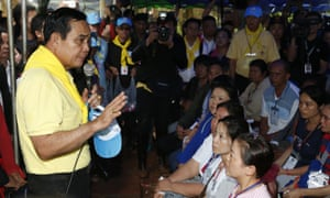 Prayuth Chan-ocha talks to family members of 12 boys and their soccer coach on Friday, June 29