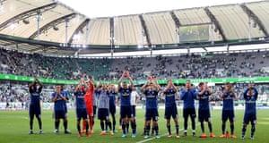 Hamburg players applaud their fans after seeing off Wolfsburg.