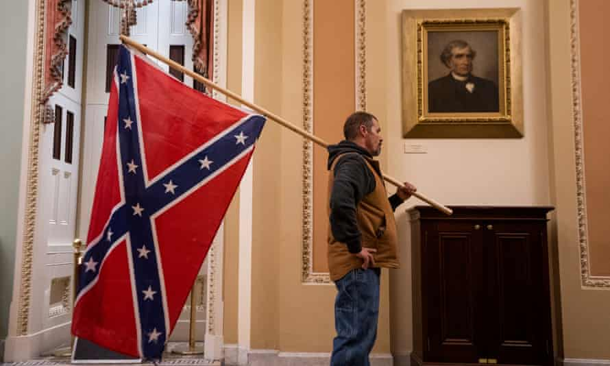 A protester carrying a Confederate flag inside the Capitol.
