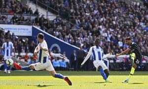 Manchester City's Riyad Mahrez scores his side's third against Brighton.