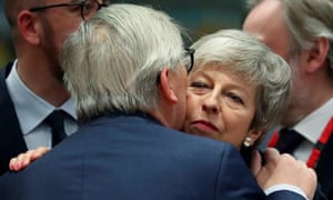 European Commission president Jean-Claude Juncker embraces Britain's prime minister Theresa May at an EU leaders summit in Brussels, Belgium, on 21 March