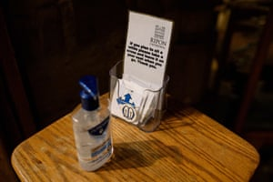 Hand sanitiser and tokens to mark seating positions are provided for members of the congregation at the entrance to the quire of Ripon Cathedral