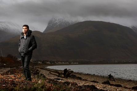 Abul Kamal Azad, a Bangladeshi man trafficked to Scotland (on the shore at Loch Linnhe with Fort William beyond)