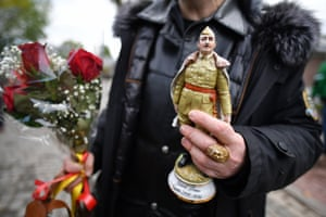 A onlooker carries Franco memorabilia