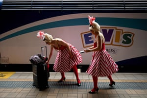 Fans and performers arrive at Central Station in Sydney to board the Elvis Express for its seven-hour trip west for the 28th Parkes Elvis festival