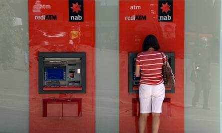 A customer uses an National Australia Bank ATM machine. The bank has allocated more than $2bn to compensate victims of dodgy financial advice.