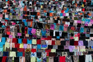 A view of the art installation 'Thinking of You' in Pristina, Kosovo, 12 June 2015. Thousands of women's dresses and skirts are hanging on clotheslines across the pitch of the capital city's main soccer stadium