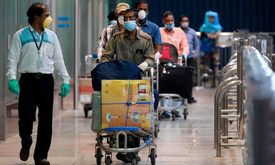 Indian citizens evacuated from Dubai on Air India flights arrive at Chennai airport.