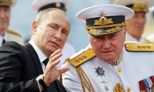 Vladimir Putin with Russian naval chief admiral Vladimir Korolev at a naval parade in St Petersburg on Sunday.