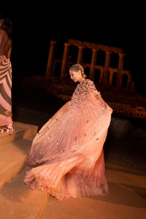 Models make their entrance onto the historic catwalk. The event was the first of its kind to take place at the Temple of Poseidon since it was built in 400BC.