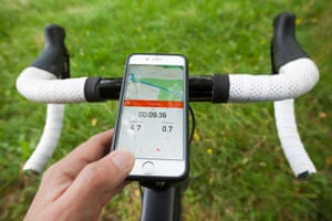 Cyclist using the Strava app on a smartphone