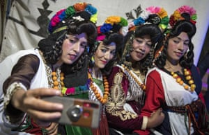 Young Amazigh (Berber) women pose for a selfie during the annual Engagement Moussem festival near the village of Imilchil. Each year in the High Atlas mountains hamlet of Ait Amer, tribes celebrate the collective wedding of young Amazigh couples with dancing and music