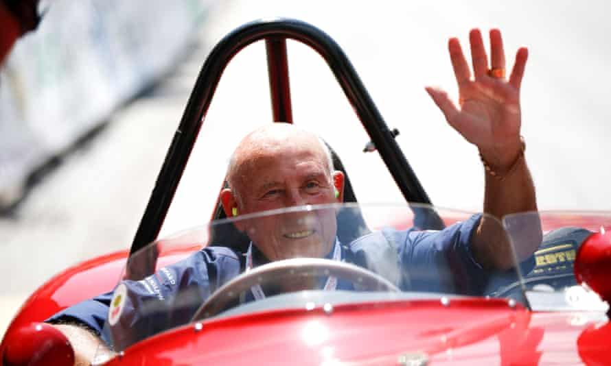 Stirling Moss waves to spectators from his 1955 Ferrari 750 Monza during the Ennstal Classic rally in Austria, 2013.