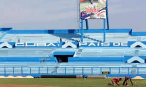 Workers at the Latinoamericano baseball stadium prepare for the game between the Cuban national team and the Tampa Bay Rays.