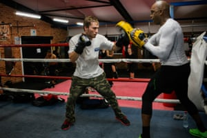 Benn training amateur fighter Gavin Smith at the Blacktown PCYC.