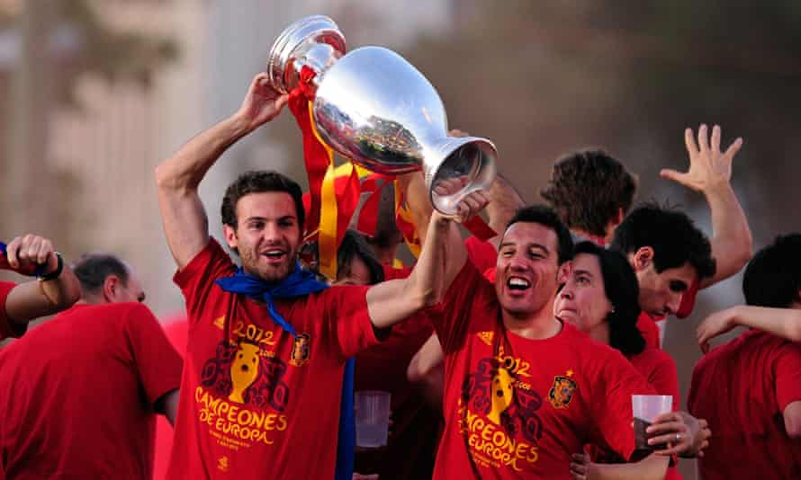 Juan Mata, left, and Santi Cazorla celebrate after Spain won Euro 2012 by beating Italy 4-0 in the final.