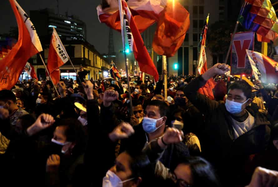 Supporters of Pedro Castillo celebrate his proclamation as president-elect of Peru in Lima on Monday night.