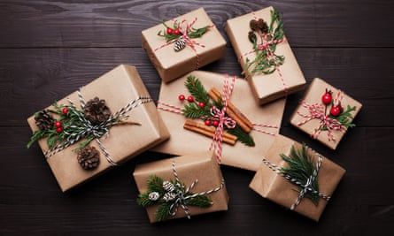 Gift or present box wrapped kraft paper with christmas decoration