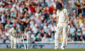 Joe Root turns to look at his wicket after being bowled by Pat Cummins.