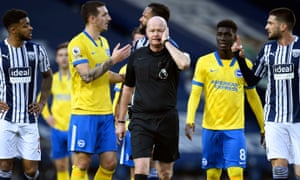 Referee Lee Mason before listen's to VAR's is it or isn't saga following a quick free kick from Brighton's Lewis Dunk found the net. In the end it was chalked off.