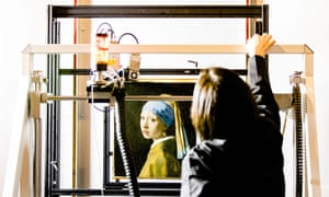 A researcher at the Mauritshuis gallery in The Hague places Johannes Vermeer's Girl with a Pearl Earring inside a scanner.