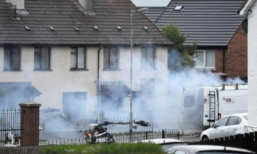 An army bomb disposal robot carries out a controlled explosion on a suspect vehicle in Derry