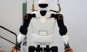 A robot with a white body and black arms
