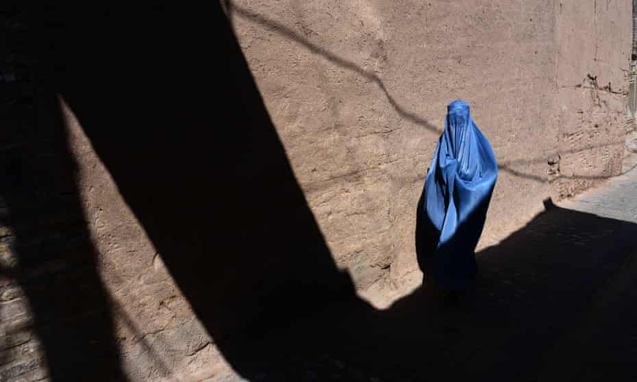 An Afghan woman walks through the old quarters of Herat