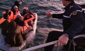People being rescued from the Channel on Friday after their boat started taking on water.