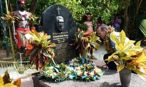 Former prime minister Tony Abbott visits the grave of land rights activist Eddie Mabo in the Torres Strait.