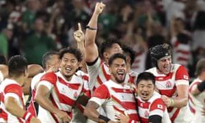Japan's players celebrate after pulling off a shock World Cup upset against Ireland.