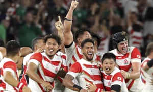 Japan's players celebrate after the final whistle.