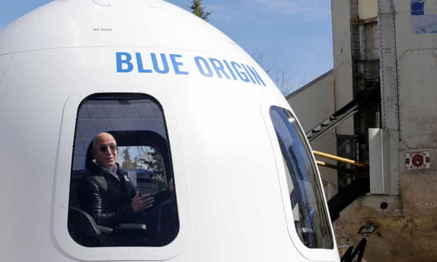 Amazon founder Jeff Bezos inside a Blue Origin 'rocket'