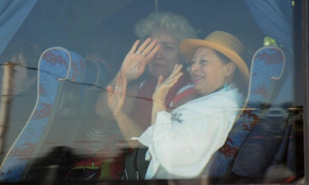 Relieved tourists wave after being driven away from the scene of the attack.