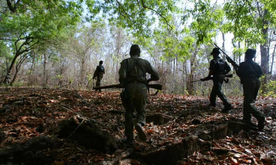 Maoist insurgents on patrol in a forest in Chhattisgarh.