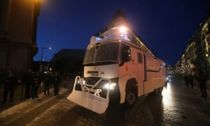A police water cannon arrives in Lille city centre.
