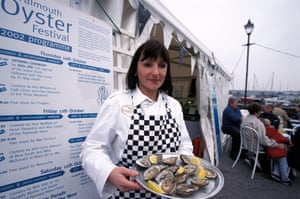 Woman serving oysters at the Oyster Festival, Falmouth